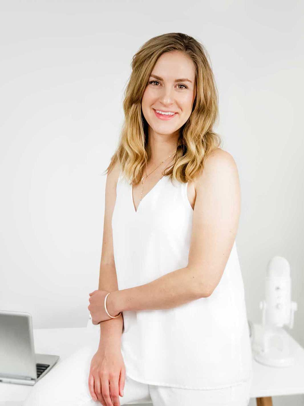 Erin Flynn dressed all in white--she'd never keep this outfit clean in real life!