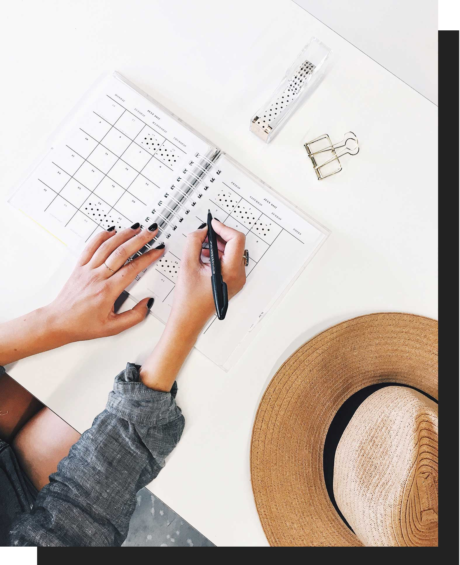 a woman using a planner at a desk